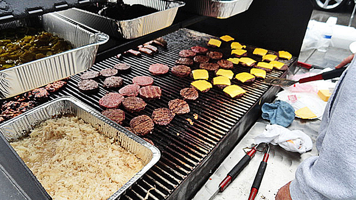 Burgers Being Grilled at Staff Potluck