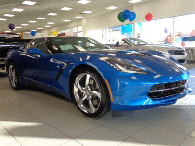 2014 Laguna Blue Chevy Corvette in a showroom