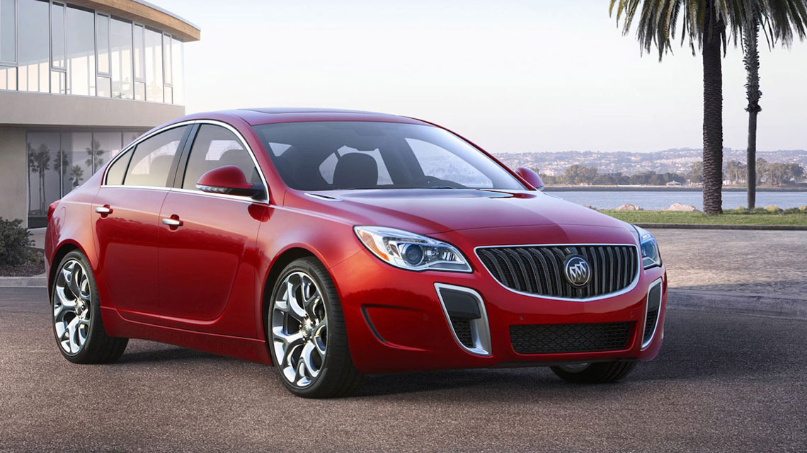Red 2014 Buick Regal in the tropics