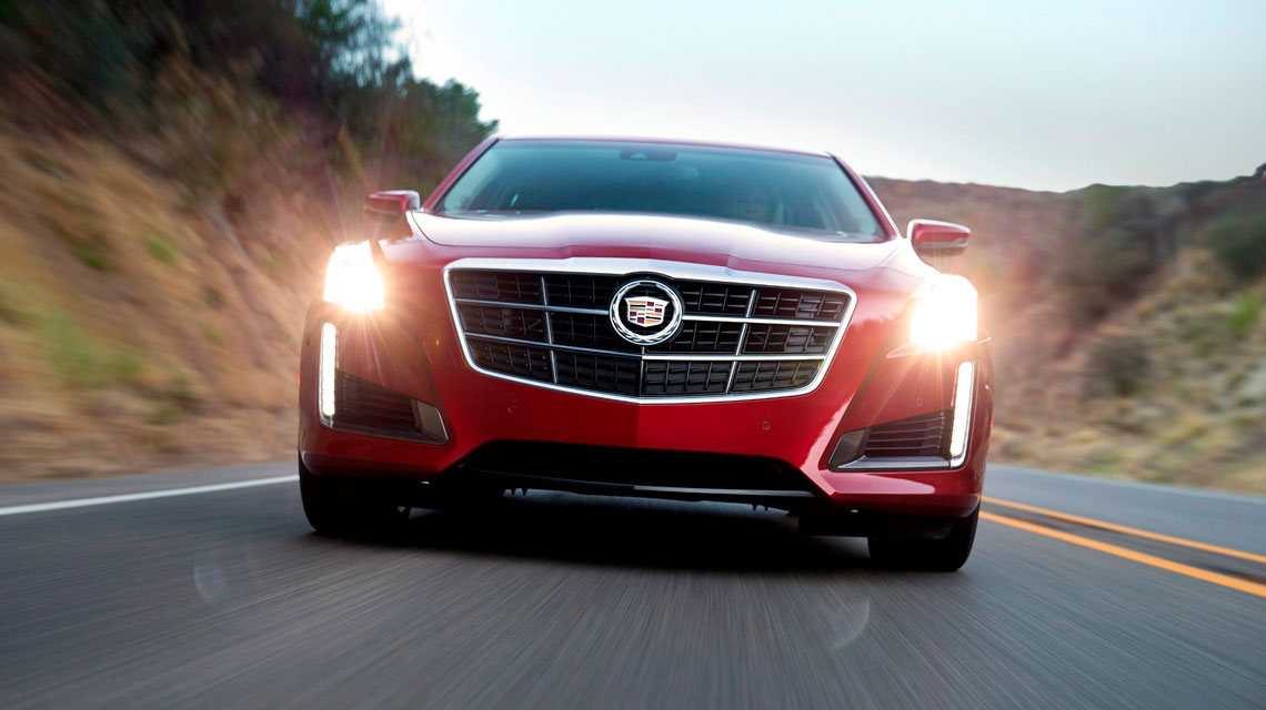2014 red Cadillac CTS driving