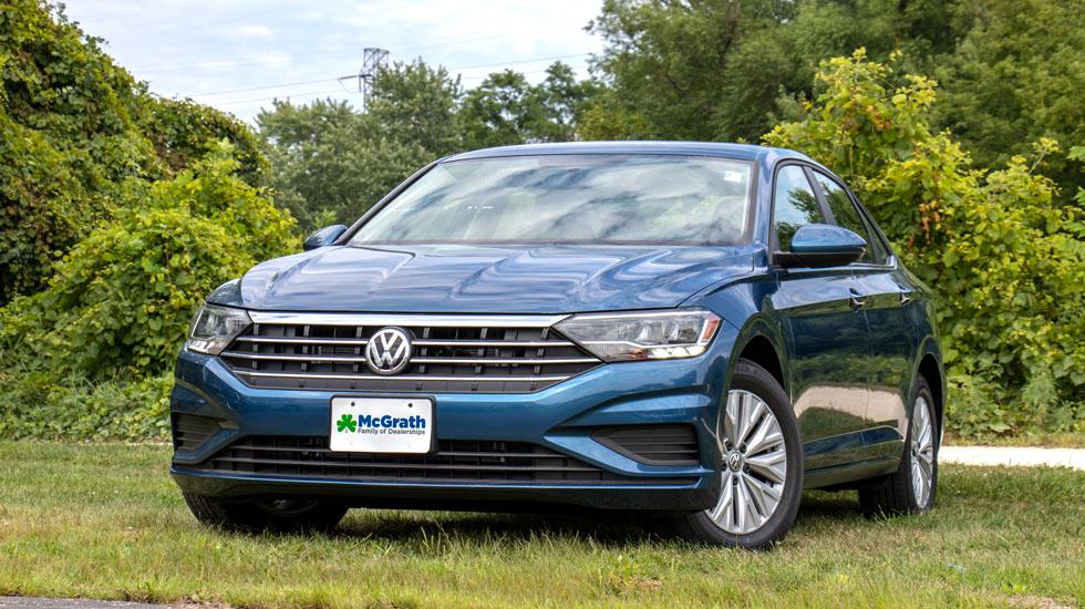 Blue 2019 Volkswagen Jetta in a field
