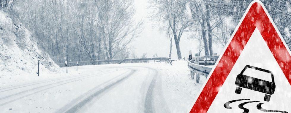 Warning sign indicating icy roads