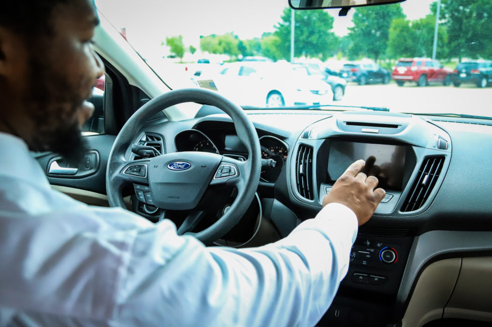 Man using Ford interior touch screen