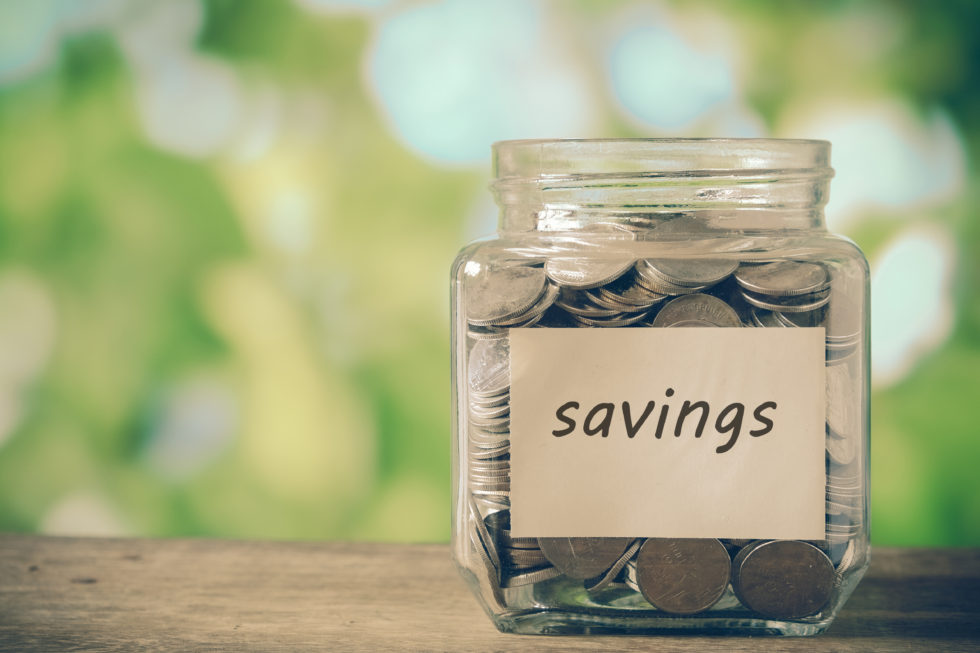 Coin jar labeled savings