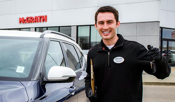 Kia Salesman holding car keys