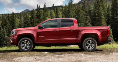 Red Chevy Colorado Parked In Field