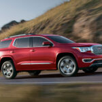 2017-GMC-Acadia-Denali-front-three-quarter-motion