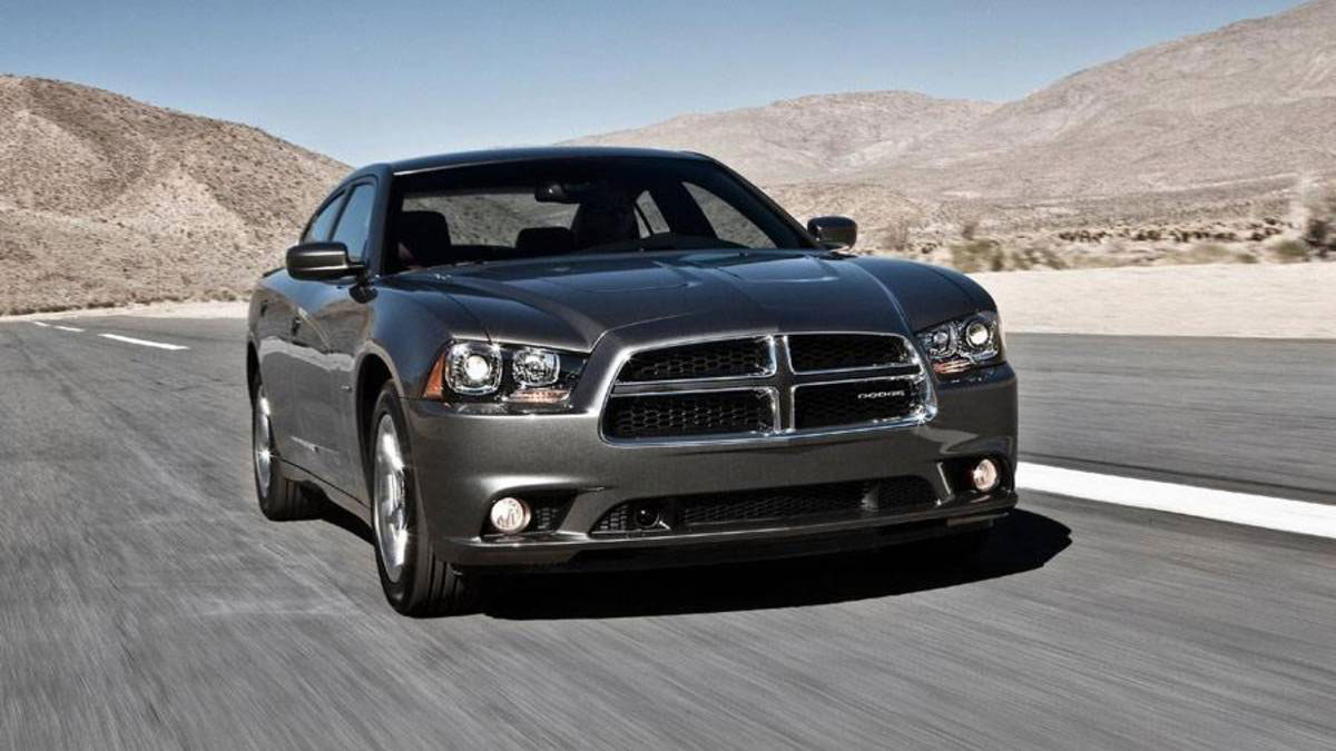 2013 Dodge Charger speeding down a road