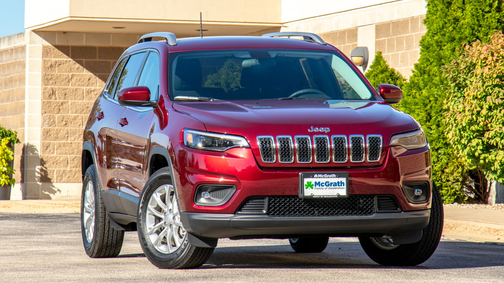 Red 2019 Jeep Cherokee in front of an office building
