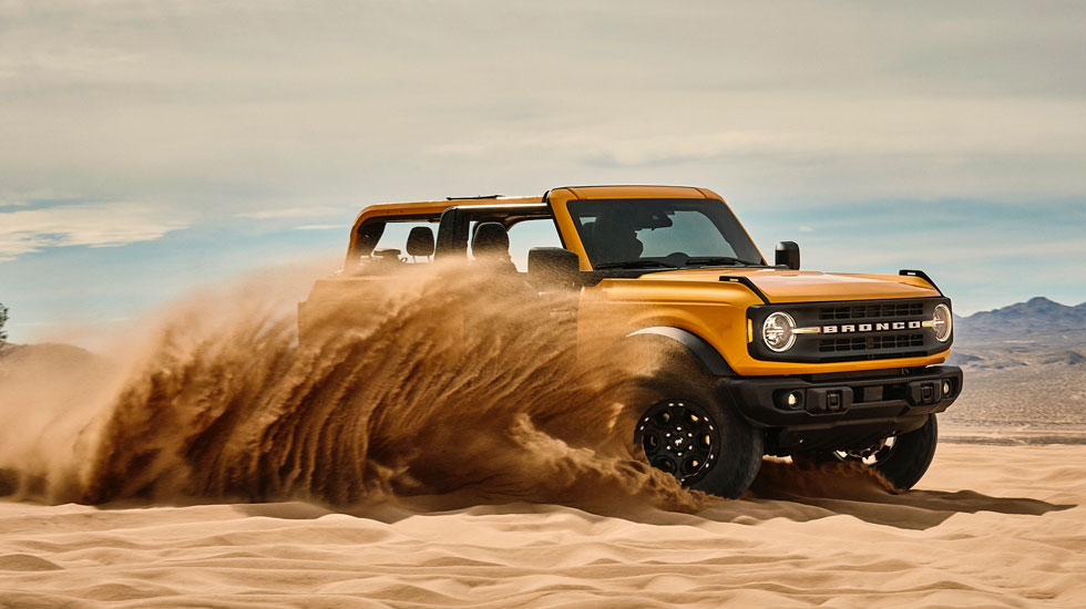 Ford Bronco driving through sand