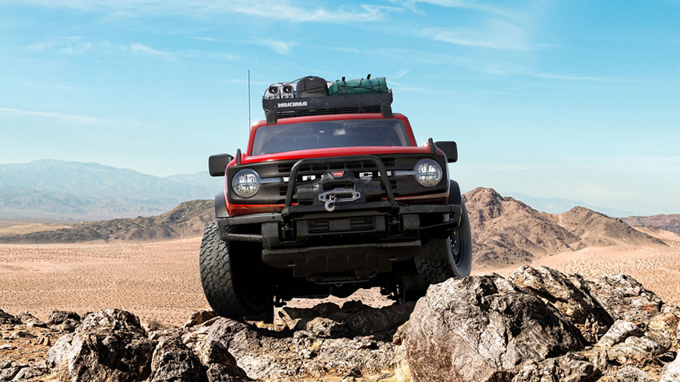 Ford Bronco driving over rocks