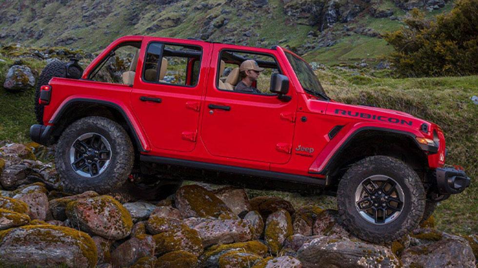 Wrangler driving over rocks