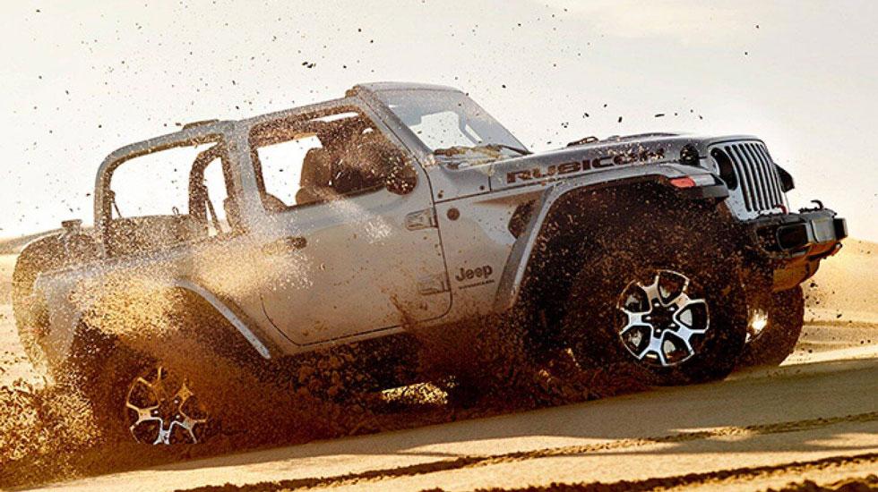 Wrangler driving through sand