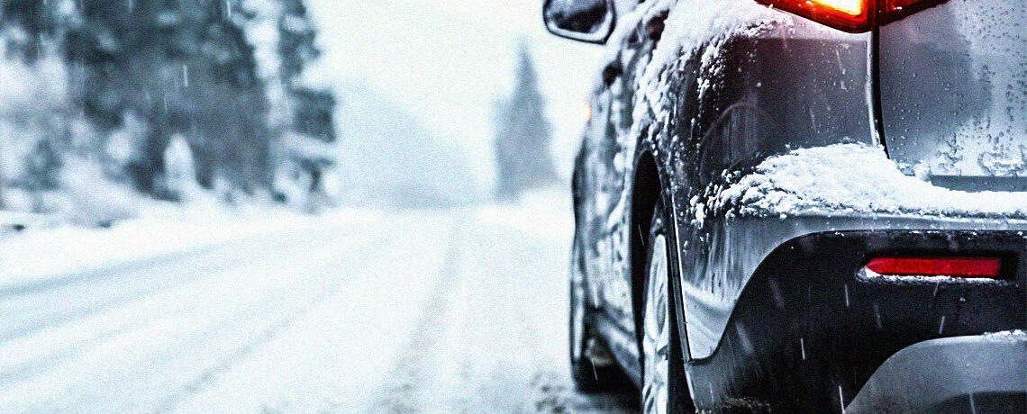 car driving through snowy icy conditions