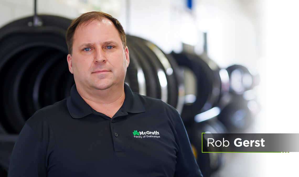 man stands in front of tires
