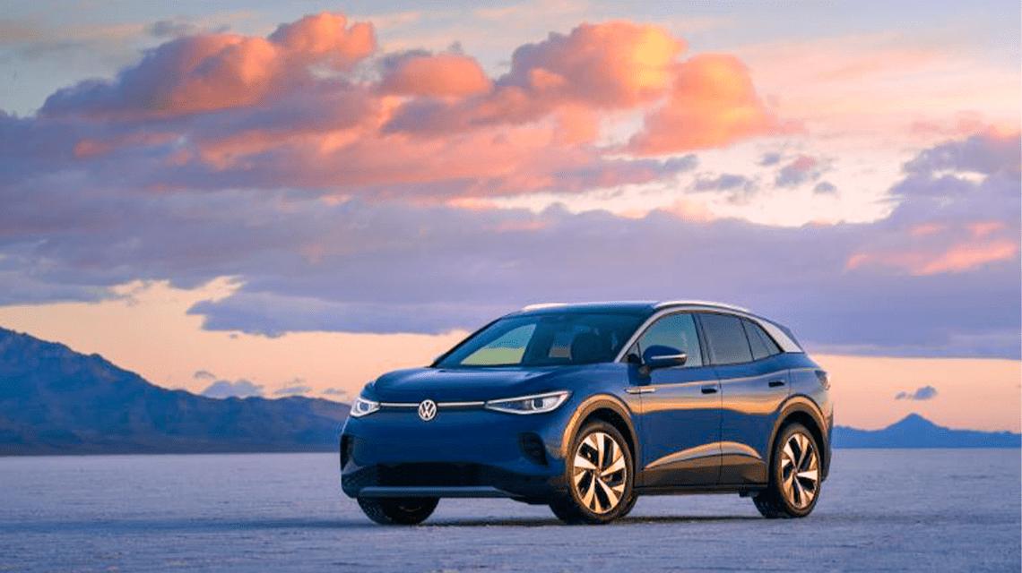 Volkswagen ID.4 in open salt flat mountain and evening sky in background.