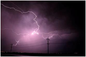lightning striking above powerlines
